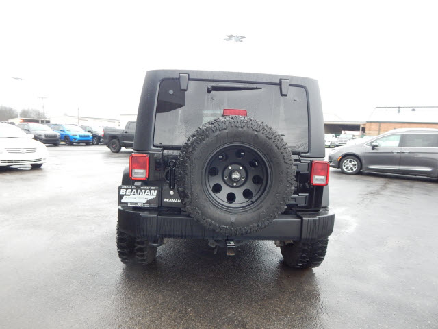 Pre-Owned 2012 Jeep Wrangler Unlimited Unlimited Sport